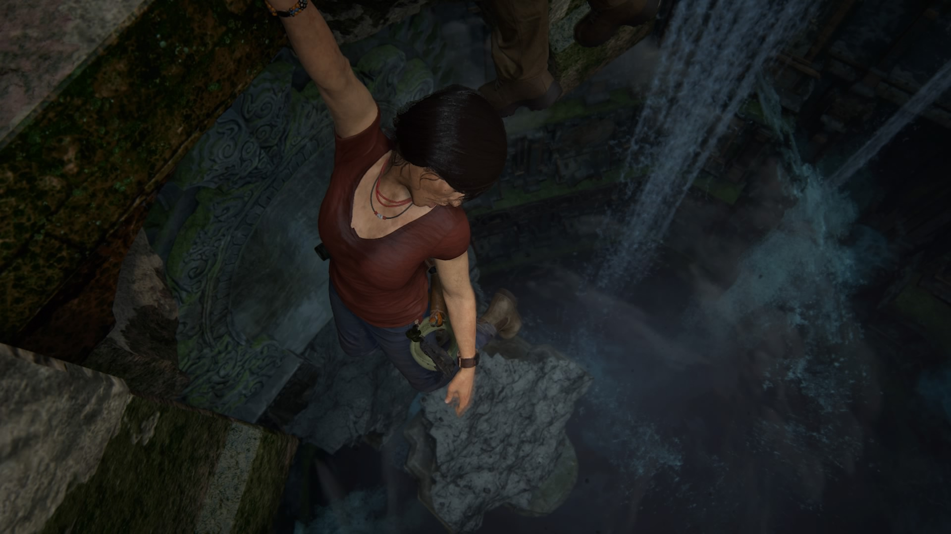 Chloe Frazer hanging on to an edge overhanging water